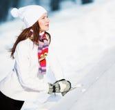 Muchacha que juega con nieve Fotos de archivo libres de regalías