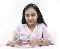 Muchacha que juega con su playstation Foto de archivo