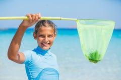 Muchacha que juega en el mar Fotos de archivo libres de regalías