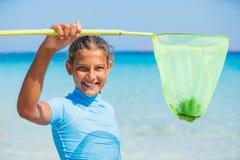 Muchacha que juega en el mar Foto de archivo libre de regalías