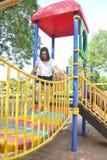 Muchacha que juega en el patio Imagen de archivo libre de regalías