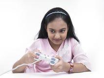 Muchacha que juega en su playstation Fotos de archivo libres de regalías