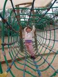 Muchacha que juega en túnel en patio Fotos de archivo libres de regalías