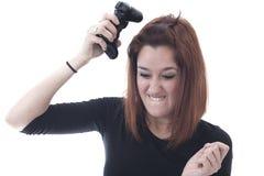Muchacha que juega enojada con un regulador del juego Fotografía de archivo libre de regalías