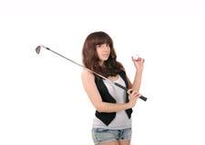 Muchacha que juega a golf Imágenes de archivo libres de regalías