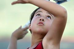 Muchacha que juega a tenis Imágenes de archivo libres de regalías
