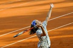Muchacha que juega a tenis Foto de archivo