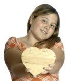 Muchacha que le da el corazón Imagen de archivo libre de regalías