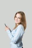 Muchacha que marca en el teléfono celular Imágenes de archivo libres de regalías