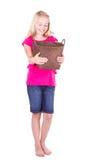 Muchacha que mira abajo en cesta vacía Fotografía de archivo
