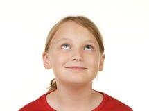 Muchacha que mira el copyspace blanco Fotos de archivo libres de regalías