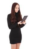 Muchacha que mira la PC de la tableta Imágenes de archivo libres de regalías
