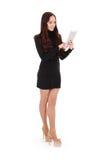 Muchacha que mira la PC de la tableta Foto de archivo libre de regalías