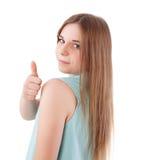 Muchacha que muestra el pulgar para arriba Fotografía de archivo libre de regalías