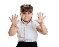 Muchacha que muestra las palmas Fotografía de archivo