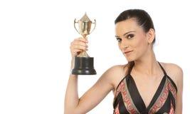 Muchacha que muestra su trofeo del oro Imagen de archivo libre de regalías
