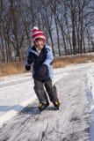 Muchacha que patina en el movimiento Fotos de archivo libres de regalías
