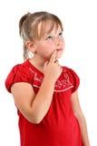 Muchacha que piensa en algo aislado en blanco Imágenes de archivo libres de regalías