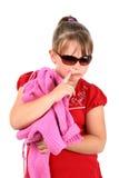 Muchacha que piensa en poner su suéter Foto de archivo libre de regalías