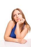 Muchacha que piensa sobre blanco Imagen de archivo