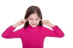 Muchacha que pone el dedo en sus oídos Fotografía de archivo libre de regalías