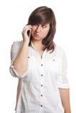 Muchacha que pone mala cara en el teléfono Imágenes de archivo libres de regalías