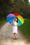 Muchacha que presenta con el paraguas Imágenes de archivo libres de regalías