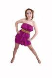 Muchacha que presenta en alineada rosada. Fotos de archivo libres de regalías