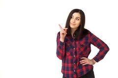 Muchacha que señala el finger lejos aislado en blanco Imagen de archivo libre de regalías