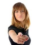 Muchacha que señala su dedo Foto de archivo libre de regalías