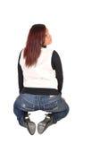 Muchacha que se arrodilla de la parte posterior. Imágenes de archivo libres de regalías