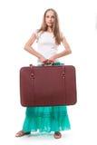 Muchacha que se coloca con la maleta Aislado en blanco Fotos de archivo