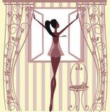 Muchacha que se coloca en la ventana Imagenes de archivo