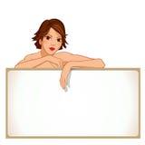 Muchacha que se inclina contra un tablero en blanco Imágenes de archivo libres de regalías