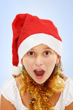 Muchacha que se pregunta de la Navidad Foto de archivo