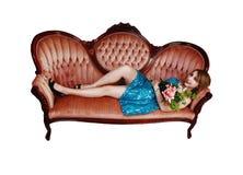 Muchacha que se reclina con las flores. Foto de archivo libre de regalías