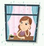 Muchacha que se sienta cerca de la ventana en día lluvioso Imagen de archivo libre de regalías
