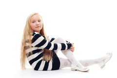 Muchacha que se sienta en el suelo Imágenes de archivo libres de regalías