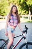 Muchacha que se sienta en la bicicleta Fotos de archivo