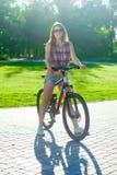 Muchacha que se sienta en la bicicleta Fotografía de archivo libre de regalías