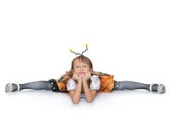 Muchacha que se sienta en la guita Fotografía de archivo
