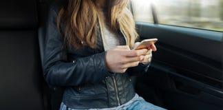 Muchacha que se sienta en un coche Imagen de archivo libre de regalías