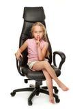 Muchacha que se sienta en una silla Fotografía de archivo libre de regalías