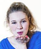 Muchacha que sopla un beso Imagen de archivo