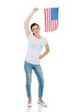 Muchacha que sostiene el indicador americano Imagen de archivo libre de regalías