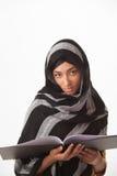 Muchacha que sostiene el libro Foto de archivo