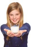 Muchacha que sostiene el vidrio de leche Fotos de archivo