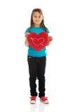 Muchacha que sostiene la almohada del corazón Fotografía de archivo