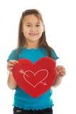 Muchacha que sostiene la almohada del corazón Fotos de archivo