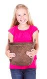 Muchacha que sostiene la cesta vacía Foto de archivo